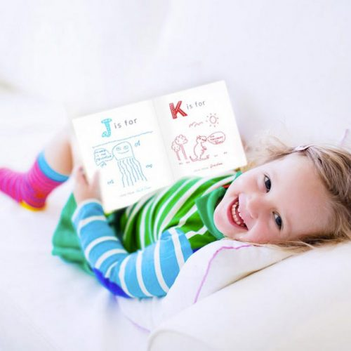 child reading keepsake baby book