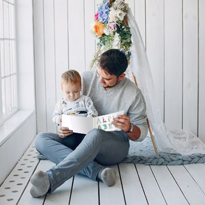 dad read with book with baby